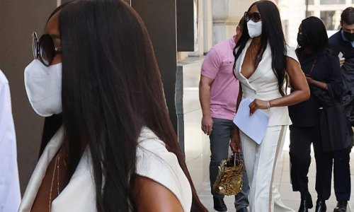 Naomi Campbell suffers wardrobe malfunction in deeply plunging jacket