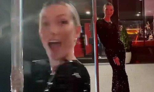 Karlie twirls around in sequined Prada gown and Manolo Blahnik boots