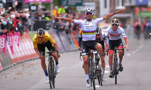 Cocky cyclist LOSES after raising his arms to celebrate too early