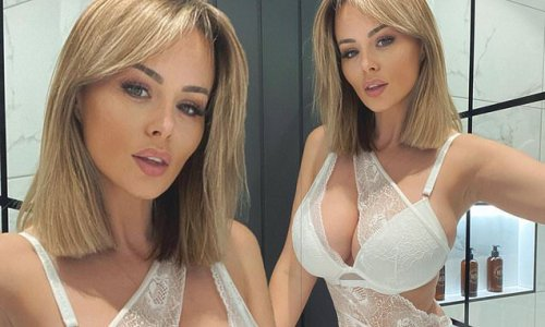 Rhian Sugden sets pulses racing in a plunging sheer lace bodysuit