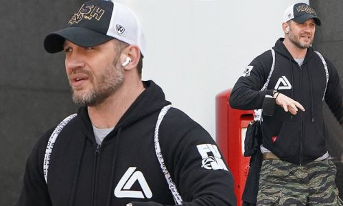 Tom Hardy heads to the gym in cargo shorts and a hoodie