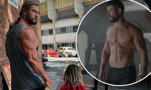 Thor star Chris Hemsworth flaunts his bulging biceps on set with son