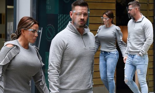Katie Price and Carl Woods hold hands after revealing IVF worries