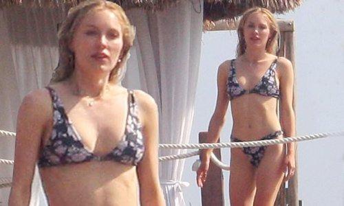 Cassie Randolph basks in the sunshine in her bikini
