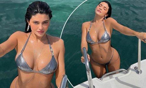 Kylie Jenner in a silver bikini after 'filing trademark Kylie Swim'