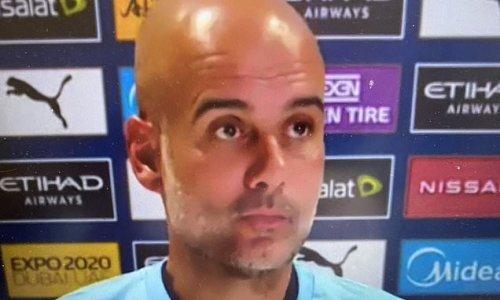 Pep Guardiola wears a t-shirt in support of Man City fan