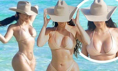 Kim Kardashian poses in a nude bikini and matching cowboy hat