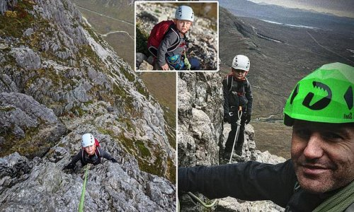 High, dad! Moment seven-year-old boy scales 3,349ft Scottish Munro