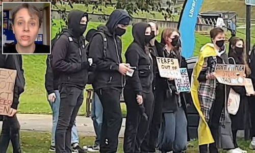 Masked mob demand trans row professor is sacked in campus protest