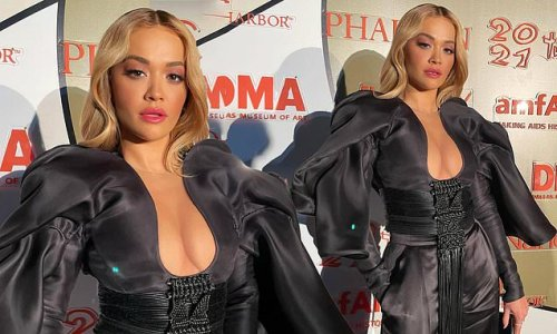 Rita Ora puts on busty display in black outfit with plunging neckline