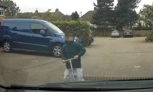 Hair-raising moment small child on scooter shoots out in front of car
