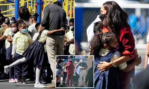 Meghan and Harry hug kids during visit to Harlem school