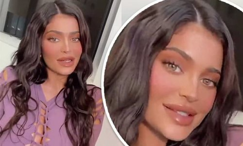 Kylie Jenner dazzles in a lilac cut-out dress that flashes cleavage