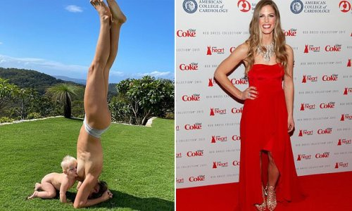 Olympic champion Torah Bright breastfeeds her son while in a headstand