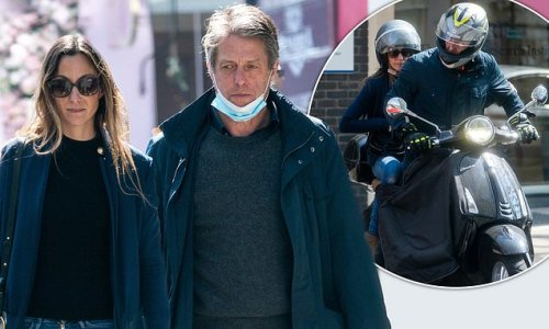 Hugh Grant and wife Anna Eberstein cruise through Chelsea on his Vespa