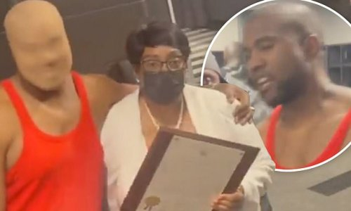 Kanye West gets pwn day. in Atlanta and an award for his late mother