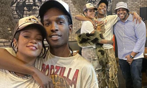 Rihanna looks smitten as her beau A$AP Rocky wraps his arm around her
