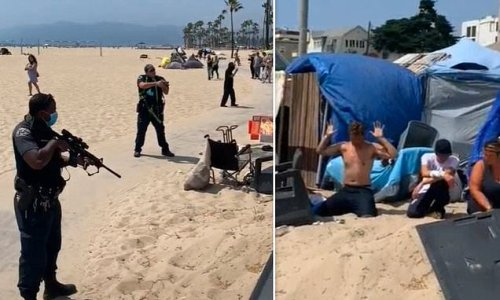 LAPD cops point assault rifles at group of homeless people at Venice