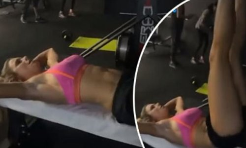 Candice Warner shows off her washboard stomach during a gym workout