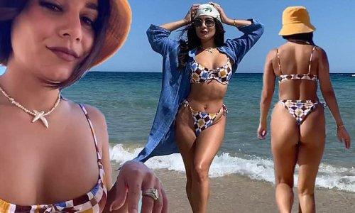 Vanessa Hudgens looks sensational as she poses on the beach