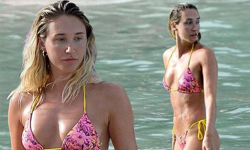 Megan McKenna showcases her incredible figure in a skimpy pink bikini