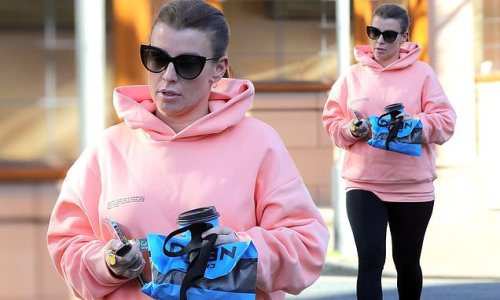 Coleen Rooney steps out for a morning coffee run in a pink hoodie