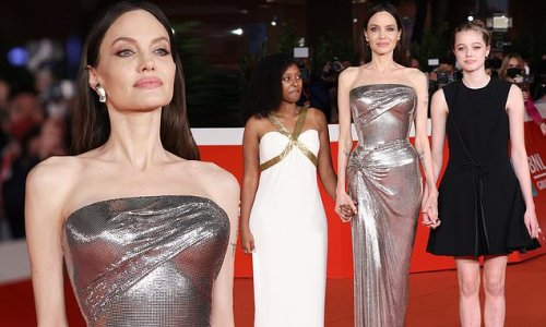 Angelina Jolie dazzles in a metallic silver gown at Eternals premiere