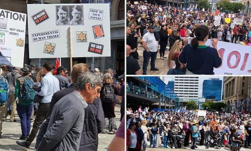 Anti-vaxxers swarm Perth CBD holding signs comparing premier to hitler