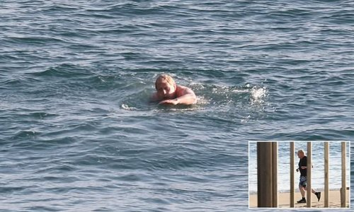 Boris Johnson goes for an early morning swim in the sea ahead of G7