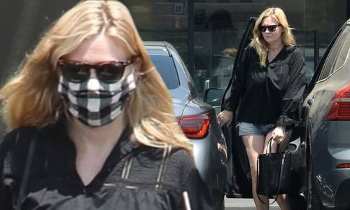 Kirsten Dunst rocks a pair of Daisy Dukes as she steps out