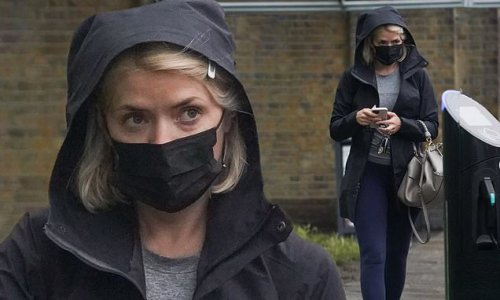 Holly Willoughby braves the rain and heads out in a hooded jacket