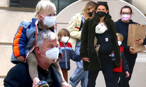 Alec Baldwin and Hilaria take four of their six children for a walk