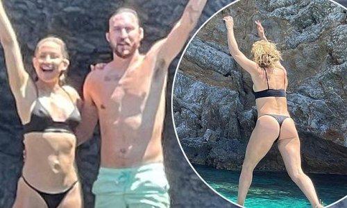 Kate Hudson shows off toned physique in skimpy black bikini in Greece