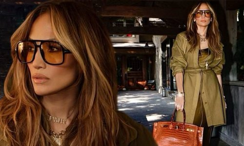 Jennifer Lopez simply stuns in a green silk dress and retro frames