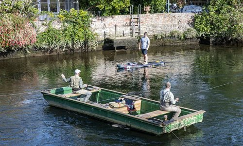 Anglers block paddle-boarders going under bridge as battle escalates