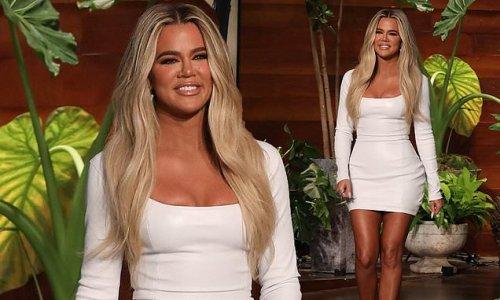 Khloe Kardashian wears a white dress stepping out onto The Ellen Show