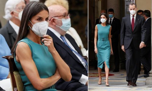 Queen Letizia of Spain is polished in a teal Hugo Boss dress