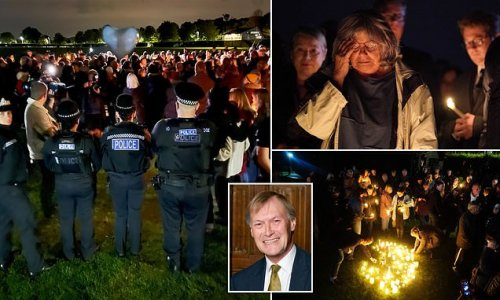 Hundreds carry lanterns and candles to remember Sir David Amess