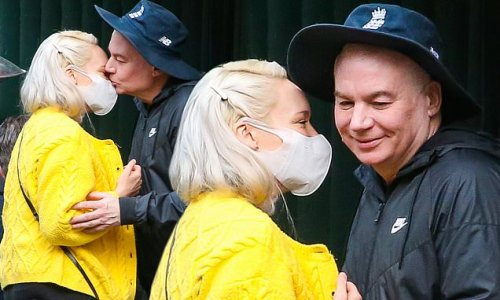 Mike Myers gives his wife Kelly Tisdale a kiss in New York City