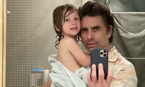 John Stamos, 57, holds son William on the child's third birthday