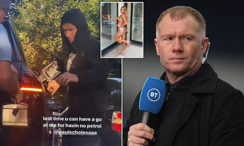 Paul Scholes is filmed using jerry can to top up his Mercedes