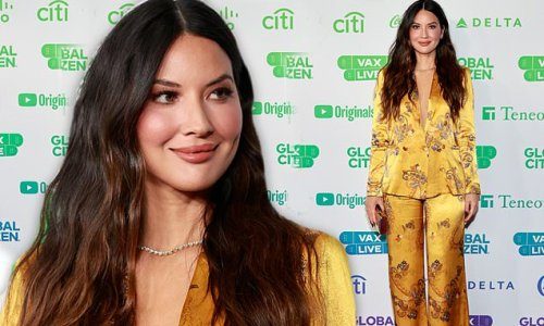 Olivia Munn looks gorgeous in silky gold pant suit at Vax Live in LA