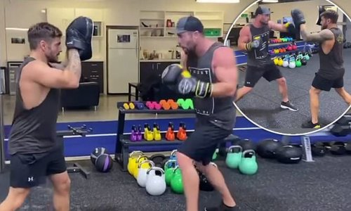 Chris Hemsworth biceps on show in boxing workout with Luke Zocchi