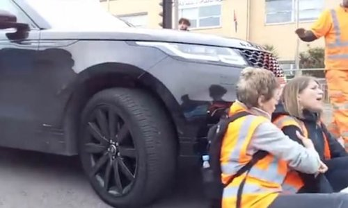 Moment mother drives into Insulate Britain activists with her 4x4