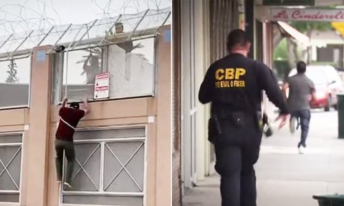 Migrant scales down from wall before border agent chases him