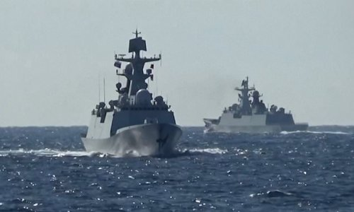 Chinese and Russian warships in first joint navy patrols near Japan