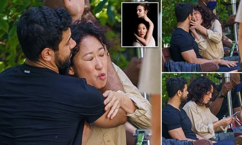 Oh no, he's killing Eve! Sandra Oh grapples with an assassin in London
