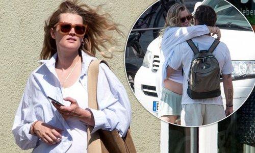 Pregnant Toni Garrn packs on PDA with husband Alex Pettyfer in Berlin