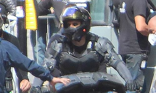 The Flash shoots scenes as Batman body double rides Batcycle