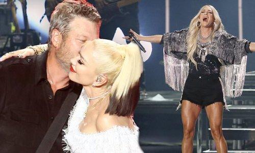 Gwen Stefani and Blake Shelton embrace at CMA Summer Jam in Nashville